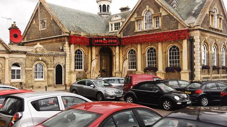 A Remembrance project has begun in Thetford to cover the Guildhall in knitted poppies. Picture: Ian