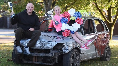 Tony Pallett of Thetford, and his daughter Ellie, 10, who is a huge banger racing fan, celebrate Ton