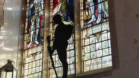 A solider silhouette in St Peter's church in Brandon. PHOTO: Terry Hawkins