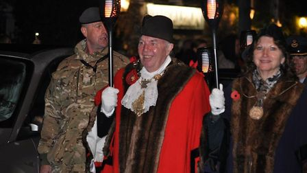 The people of Thetford honour the fallen 100 years after Armistice Day with a parade and fireworks.