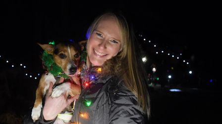 Dogs and their humans taking part in the Bark in the Dark in Thetford Forest. Abbi Lawrence and Jack