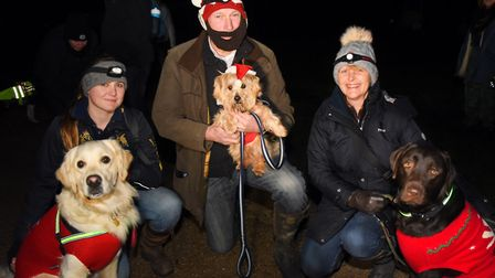 Dogs and their humans taking part in the Bark in the Dark in Thetford Forest. From left, Charlie Bea