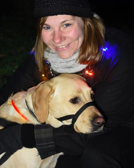 Dogs and their humans taking part in the Bark in the Dark in Thetford Forest. Louisa Hayton and Evie