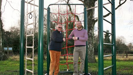 Councillor Philip Cowen inspects the new play facilities with Wretham Village Hall. Picture: Breckla