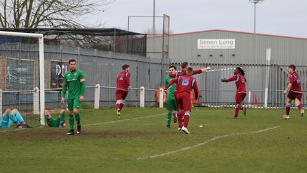 Thetford Town celebrate Nathan Clarke's dramatic late winner against Ely City on Saturday Picture: C