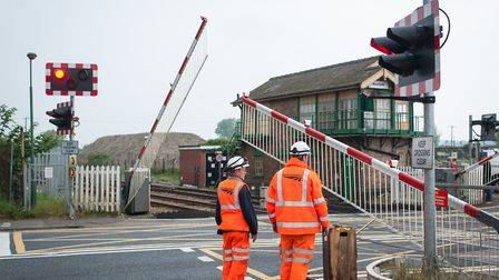 Engineers working to repair the Brandon railway level crossing in 2014. Photo: Bill Smith