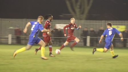 Valter Rocha brings the ball forward for Thetford Town against Histon on Friday evening with Harry H