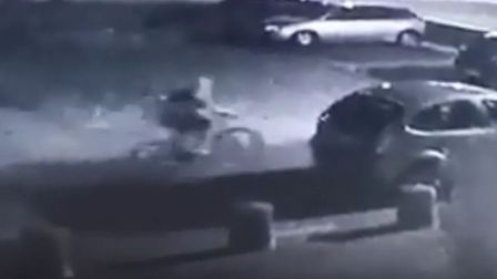 CCTV footage shows a hooded figure on a bicycle that may have been stolen from St John's Way in Thet