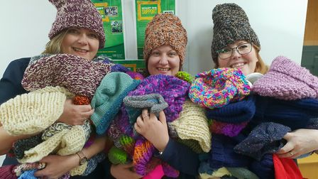 Some of the haul of hats, with (left to right) branch managers Sharon Clark, Thetford, Charley McIlw