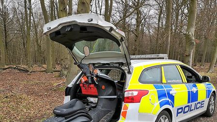 Mildenhall Police found a novel way of recovering this abandoned moped in Brandon Country Park. PHOT