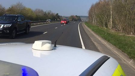 Officers from Breckland police attending a broken down car on the A11. Picture: Norfolk Constabulary