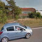 Emergency services were called to a fire in the forest opposite Sainsbury's on London Road in Thetfo