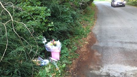 Floral tributes to Luke Ware on the corner of Foulden Road, near Didlington, where he died in a road
