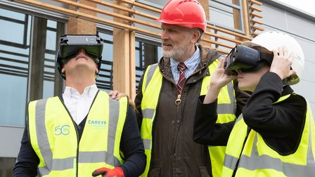 Thetford Grammar student James Stevenson Rutter (R) gets a glimpse of the future of construction wit