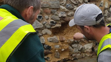 Volunteers taking part in the repairing of the wall. Picture: Marc Betts