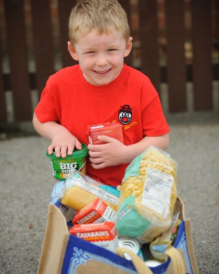 Children from Busy Bees Nursery in Thetford collected food items in 2014. Picture by: Sonya Duncan