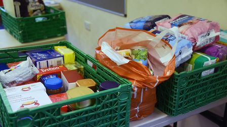 Food boxes are handed out for each person in a household. Picture: DENISE BRADLEY