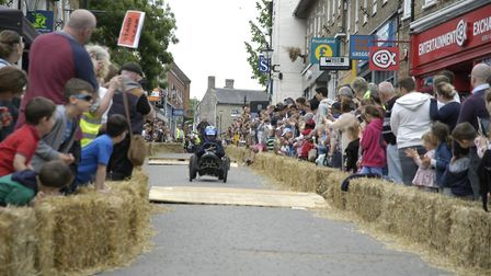 Crowds watch as teams race down Kings Street in the Thetford Soapbox Challenge with prizes for the f