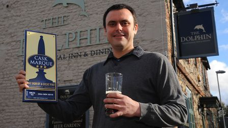 Co-owner of The Dolphin pub in Thetford, Sean Licence, with the Cask Marque award before its closure