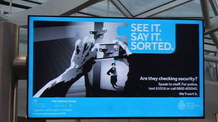 A sign at a railway station warns travellers to be on the alert for terror suspects. Picture: Chris