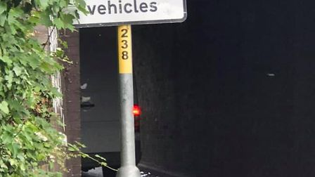 A van has got stuck under a low bridge despite warning signs being painted on it. Picture: Daniel Ho