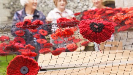 Brandon in Bloom covered St Peter's spire with thousands of knitted, crocheted and fabric poppies fo