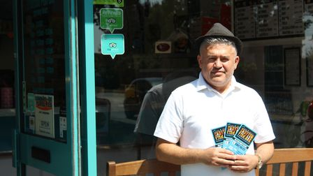 Alex Gold, one of the owners of Croxton Fish Bar, in Thetford, is angry his menu has been stolen. Pi