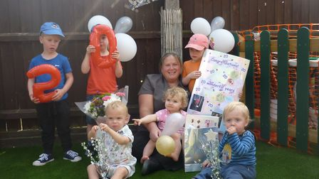 Claire Smith celebrating her 20 years with some of the youngsters. Picture: Busy Bees
