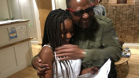 Kudzi Garikayi (head girl) opening her A-level results at Thetford Grammar School with her father, R