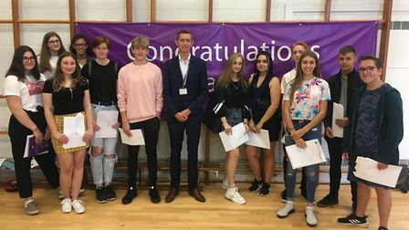 Principal Dan Carter (middle) at Thetford Grammar with his year 11 students who have just recieved