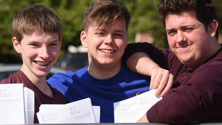 Students at Wayland Academy celebrate their GCSE results. From left, Adam Lucas, Charlie Parrott and
