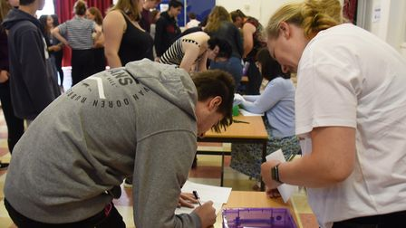 Students at Wayland Academy sign for their GCSE results. Picture: DENISE BRADLEY