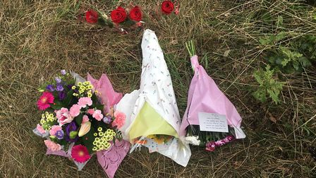 Flowers left at scene following fatal crash on A1075 at Hockham. PIC: Emily Thomson.