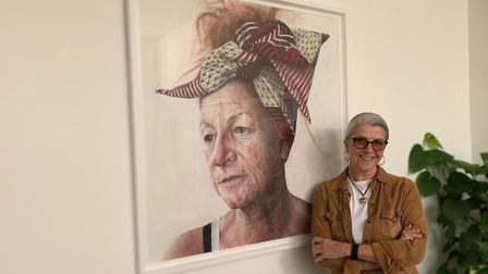Award-winning artist, Melodie Cook, with the pastel portrait of her best friend, Maria Vejente, who