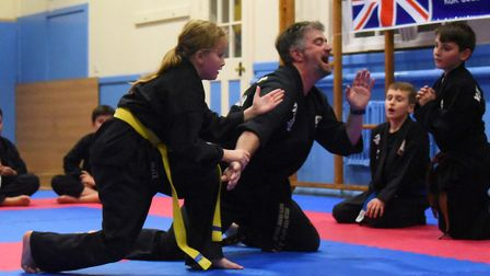 Kris French, former police officer, is thrown by Ella Boughton at his Kuk Sool Won school at Thetfor