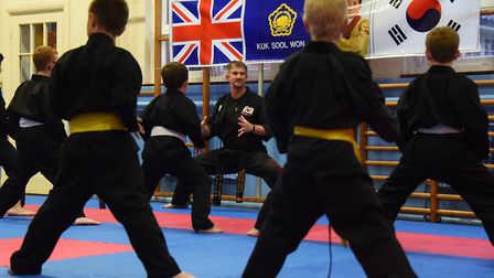 Kris French, former police officer, with the younger members of his Kuk Sool Won school at Thetford.