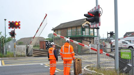 Engineers checking the level crossing after carrying out repairs. Photo: Bill Smith