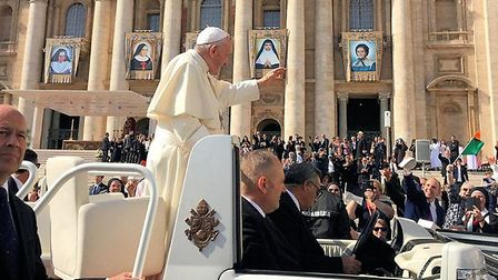 Pope Francis giving a blessing to Paul Gilbert, who is waving his Zucchetto, and his grandmother Hen