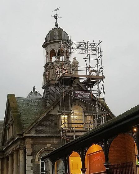 A replica of Thetford's statue of justice has been returned to its home on top of the Guildhall. Pho