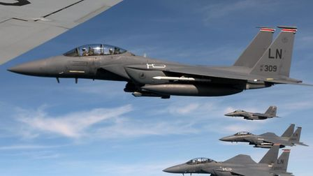 U.S. Air Force F-15E Strike Eagles assigned to the 494th Fighter Squadron at RAF Lakenheath fly alon