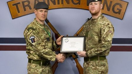 From left: Officer Commanding Training Wing, Wing Commander Stephen Turner presents certificate to A