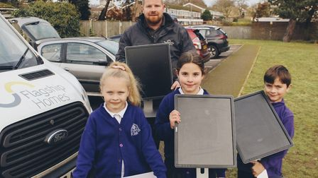 Ant Yallop from Flagship delivering the computer screens to The Bishop's CE Primary Academy. Picture