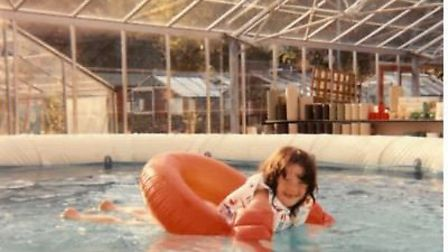 Lucy Hinkley swimming in a pool at her parents garden centre in the 1980's. Photo: Lucy Hinkley