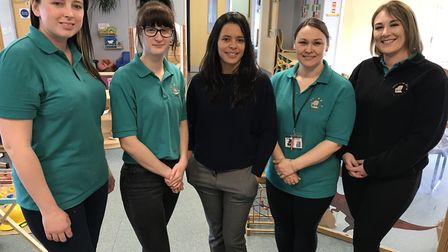 Director Ana Ribeiro (centre) with staff at Jelly Tots Nursery in their new home at the former Sure