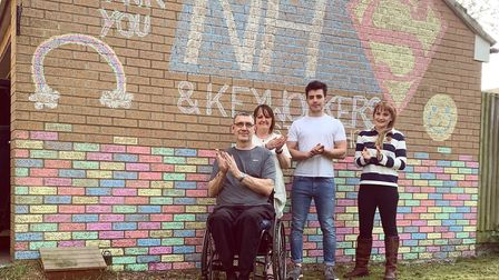 (left to right) Paul Brown, Kat Brown, Michael Brown and Helen Brown decorated the side of their hom