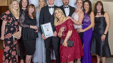 Richard Taylor owner of Tiger Fitness and his members at the Thetford Business Awards in 2019. Photo