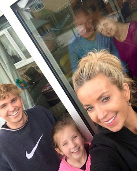 Rachel Ellis and her children visiting her parents outside of their home in Thetford. Photo: Rachel