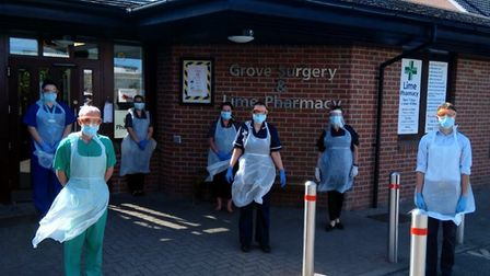 Staff at Grove Surgery in Thetford in full PPE. Photo: Jettie Vije