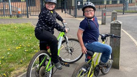 Taylor Finch, 11, and Cian Finch, 9, have been completing a 100 mile bike ride to raise money for th