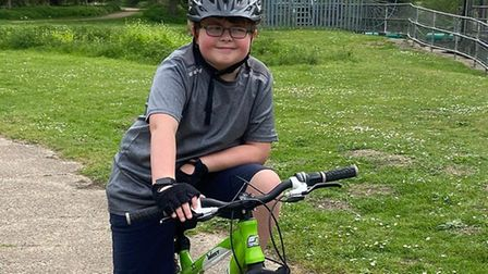 Taylor Finch, 11, has been completing a 100-mile bike ride with his brother to raise money for the N